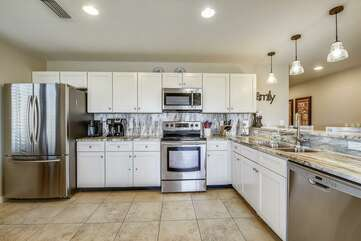 Kitchen is fully stocked and has stainless steel appliances