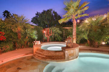 The oversized backyard has so many fun areas to relax and enjoy you company. Relax in the spacious hot tub while you watch the desert sunset.