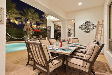 Enjoy dinner on the patio dinning table with room for eight on the comfy and spacious chairs.