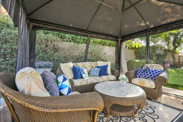 Room for five or more on the comfortable patio furniture.