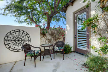 As you enter the coutyard you are greeted with a coffee table for two and access to Bedroom 2.