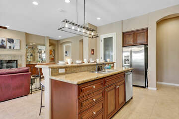 Just because you are cooking doesn't mean you have to miss out on the fun, this open floor plan allows the chef to enjoy family time too!