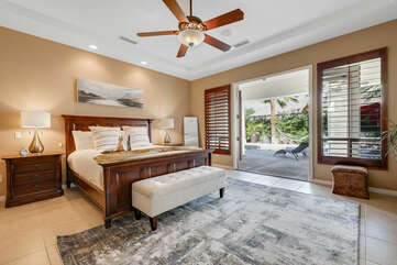 Master Suite 1 is located down the hall from the living room and features a King-sized Bed and a 40-inch Samsung Smart television.