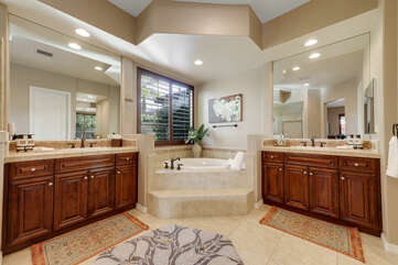 The Master Suite Bathroom features a soaking tub, tile shower and his and hers vanity sinks, and a makeup counter.