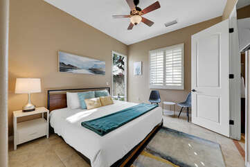 Bedroom 2 is located next to the front door and features a Cal King-sized Bed and reach-in closet with access to the front courtyard.