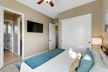 Bedroom 2 features a 50-inch HiSense with roku Smart television and a shared, jack and jill bathroom featuring a shower and tub combo and two vanity sinks.