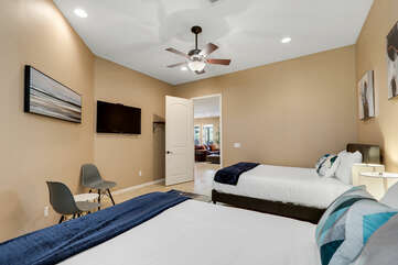 Bedroom 5 is located across from the hallway bathroom and features two Queen-sized Beds and a 46-inch Westinghouse HD television.