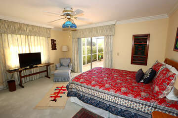 Master bedroom with Queen bed with TV and lanai