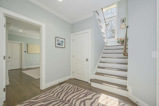 Entry to first floor bedroom and stairs to upper level #1-445 Lower County Rd Harwich- Cape Cod- New England Vacation Rentals.