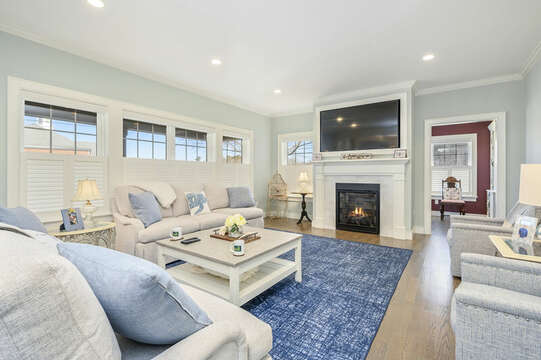Living room with large flat screen tv ( fireplace is not for guest use) 445 Lower County Rd Harwich- Cape Cod- New England Vacation Rentals.
