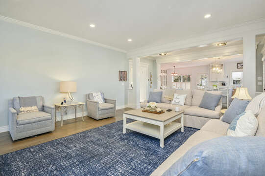 Living room opens to kitchen and dining-445 Lower County Rd Harwich- Cape Cod- New England Vacation Rentals.