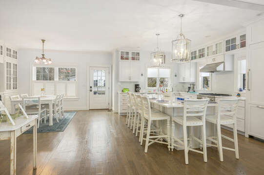 Large kitchen with center island and dining area-445 Lower County Rd Harwich- Cape Cod- New England Vacation Rentals.