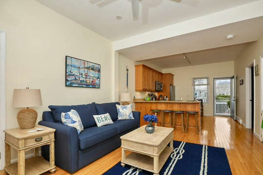 Living room into dining area at breakfast bar in kitchen - 25 Bank Street Unit #2 Harwich Port - New England Vacation Rentals