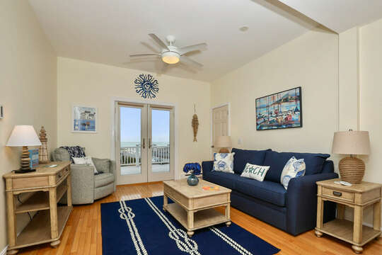 Comfy living room with sliders to deck overlooking Bank Street Beach - 25 Bank Street Unit #2 Harwich Port - New England Vacation Rentals