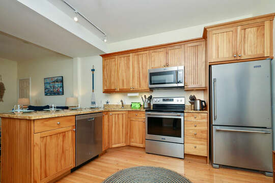 New stainless steel appliance in fully stocked kitchen - 25 Bank Street Unit #2 Harwich Port - New England Vacation Rentals
