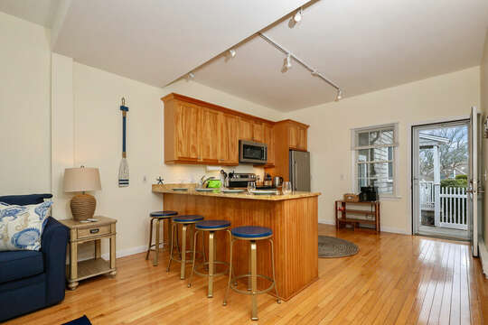 Breakfast bar seats four for dining - 25 Bank Street Unit #2 Harwich Port - New England Vacation Rentals