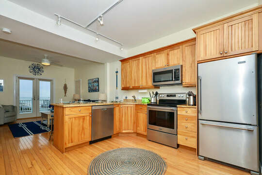 Open concept kitchen into living room - 25 Bank Street Unit #2 Harwich Port - New England Vacation Rentals