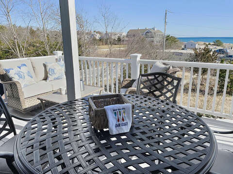 Dining With A View from the back deck - 25 Bank Street Unit #2 Harwich Port - New England Vacation Rentals