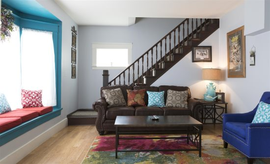 Historic Cody charm in the living room with queen sofa sleeper