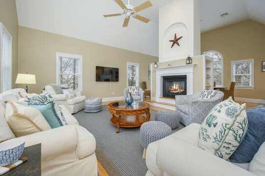 Second level- Open concept living room. Center fireplace with built in shelving-51 Nantucket St Hyannis - Cape Cod- New England Vacation Rentals