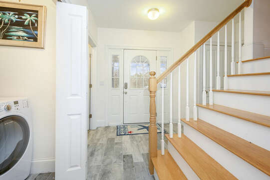 First floor hall, stairs to second level and a peak at the laundry room-51 Nantucket St Hyannis - Cape Cod- New England Vacation Rentals