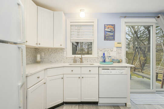 First Floor kitchen, slider to  back yard with deck with grill and swing-51 Nantucket St Hyannis - Cape Cod- New England Vacation Rentals