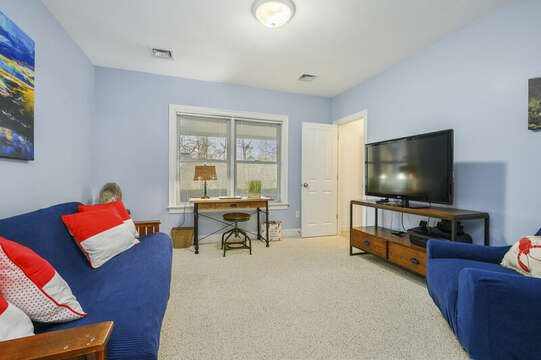 First Floor additional living room with flat screen tv and desk-51 Nantucket St Hyannis - Cape Cod- New England Vacation Rentals