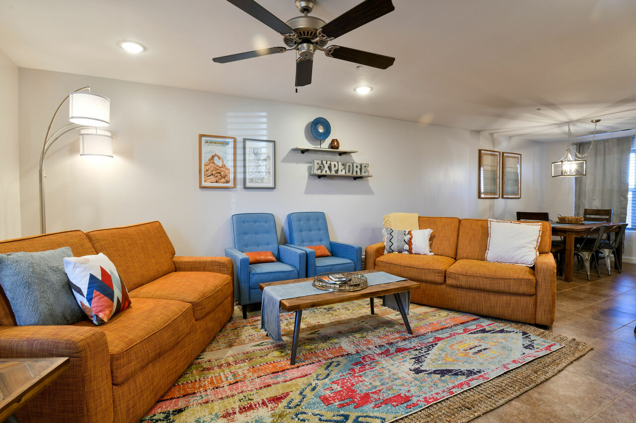 Sofas, Arm Chairs, Coffee Table, Floor Lamp, and Ceiling Fan.