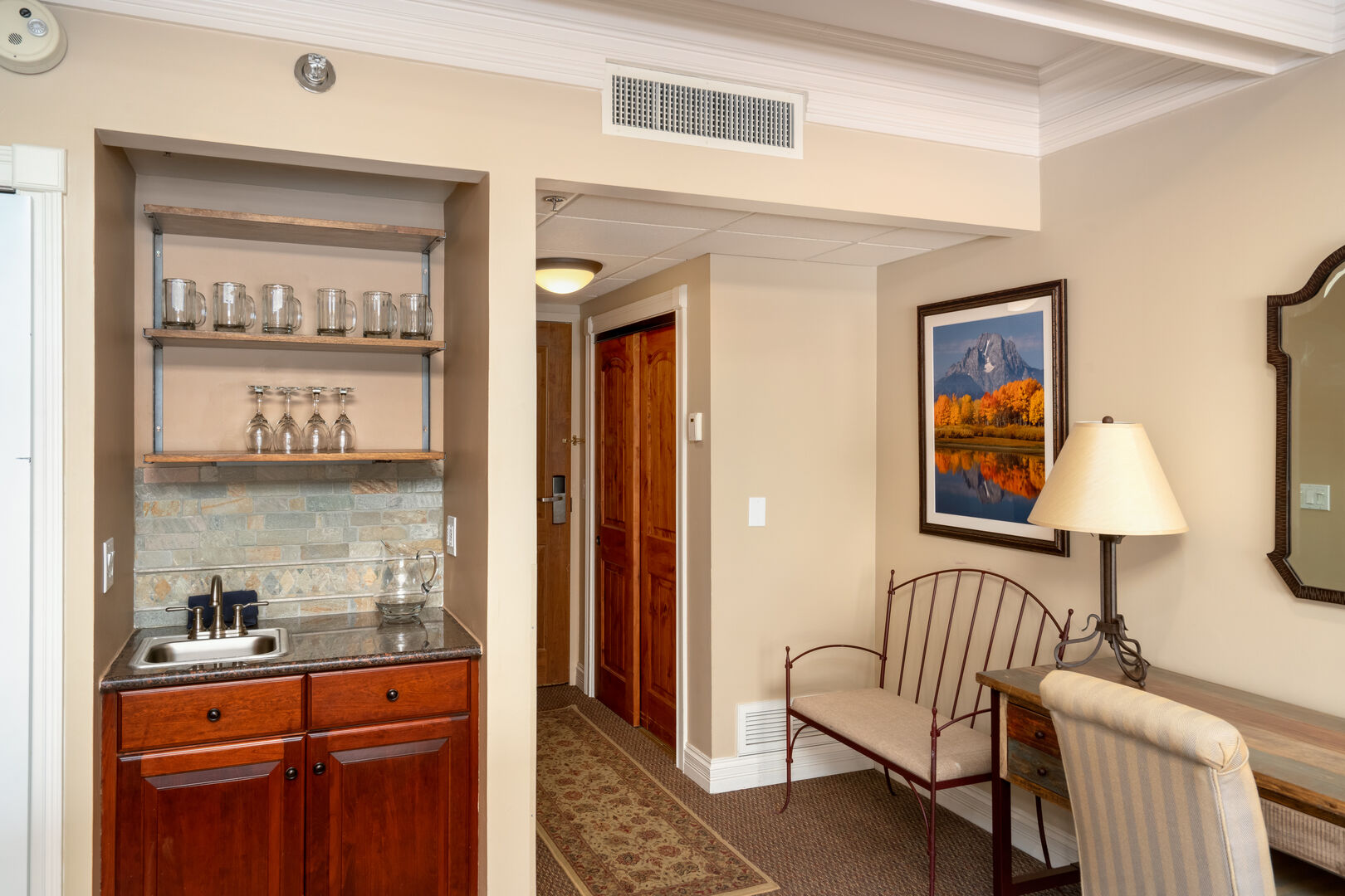 Entryway with large closet to store your gear, desk to complete work on and wet bar area.