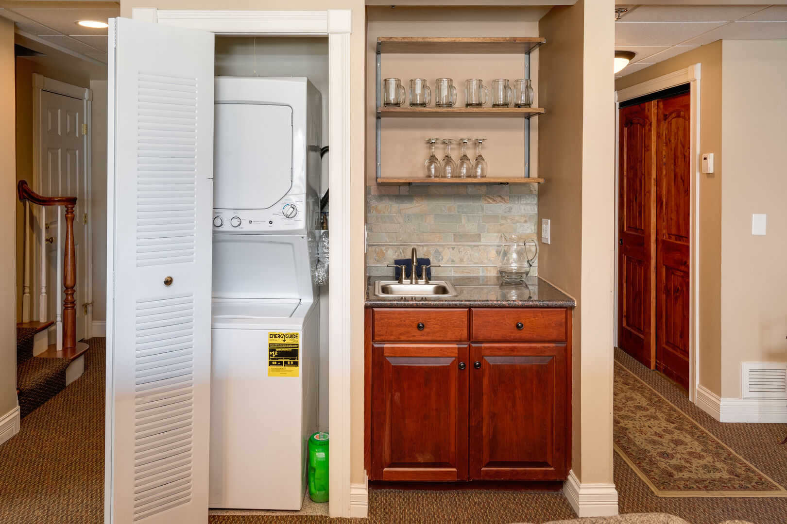 Washer and dryer behind the accordion door, Dedicated wet bar for happy hour.