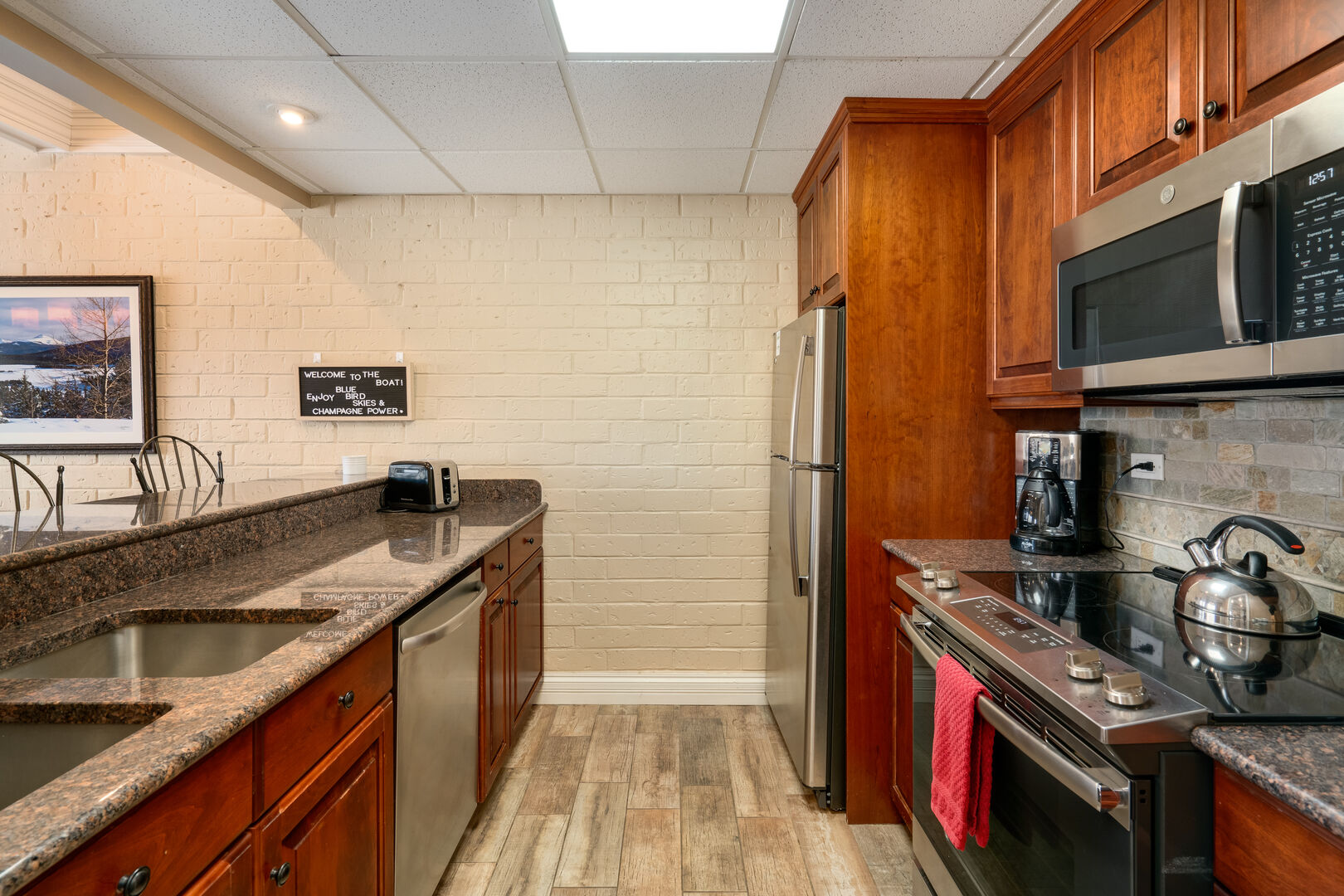 Stainless appliances in our efficient kitchen.