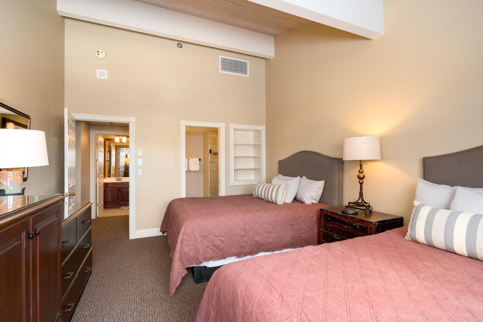 Bedroom 1 with 2 queen beds.