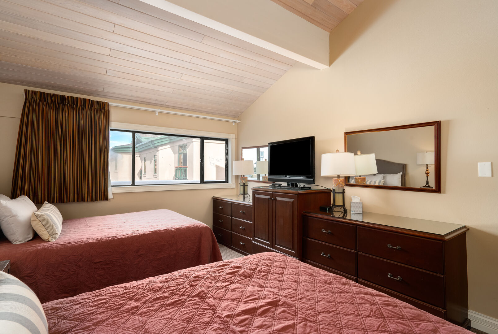 Large, airy bedroom with vaulted ceiling