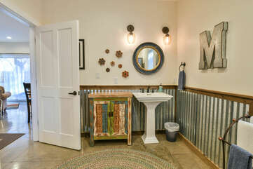 Pedestal Sink, Mirror, and Wall Lamps.