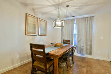 Dining Table, Chairs, Window, and Pendant Lamp.