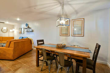 Dining Table, Chairs, Pendant Lamp, Two Sofas, and Arm Chairs.