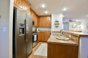 Kitchen with Bar, Refrigerator, Stove, and Microwave.