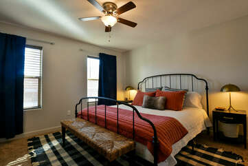 Large Bed, Nightstands, Table Lamps, Bench, and Ceiling Fan.
