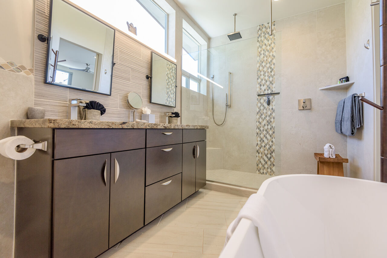 Master Bath with a Free Standing Soaking Tub and Shower with Two Shower Heads