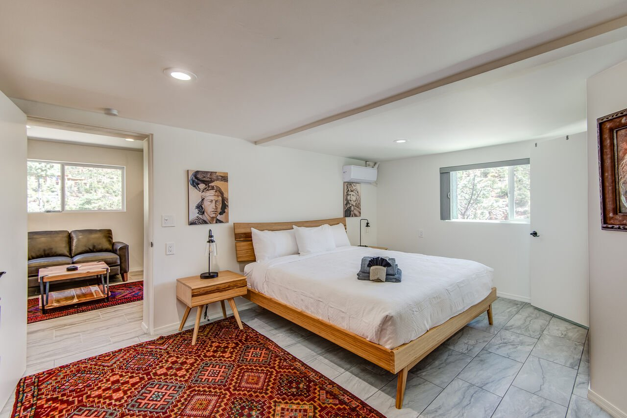 Lower Level Apartment with a Living Area and Master Bedroom 3 with a King Bed