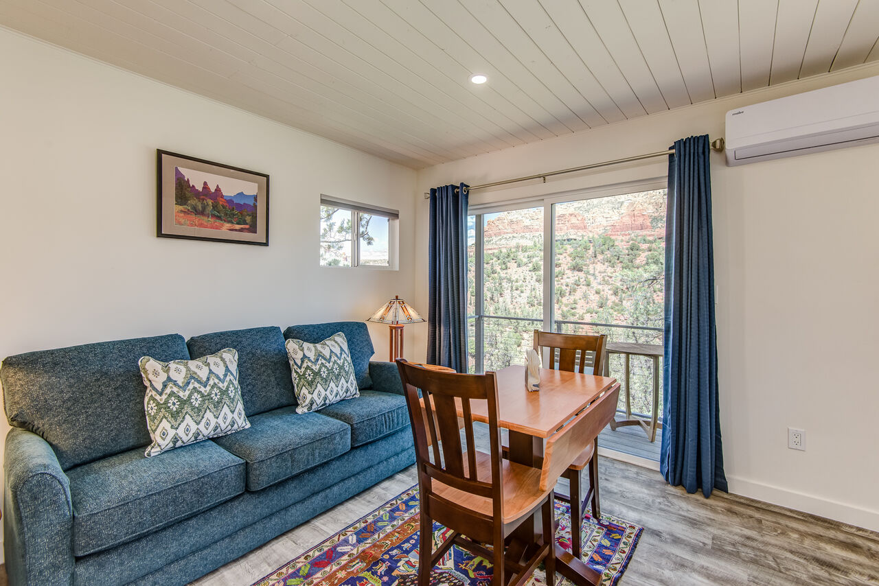 Lower Level Studio with a Queen Sleeper Sofa, Dining Table and Balcony with Stunning Views