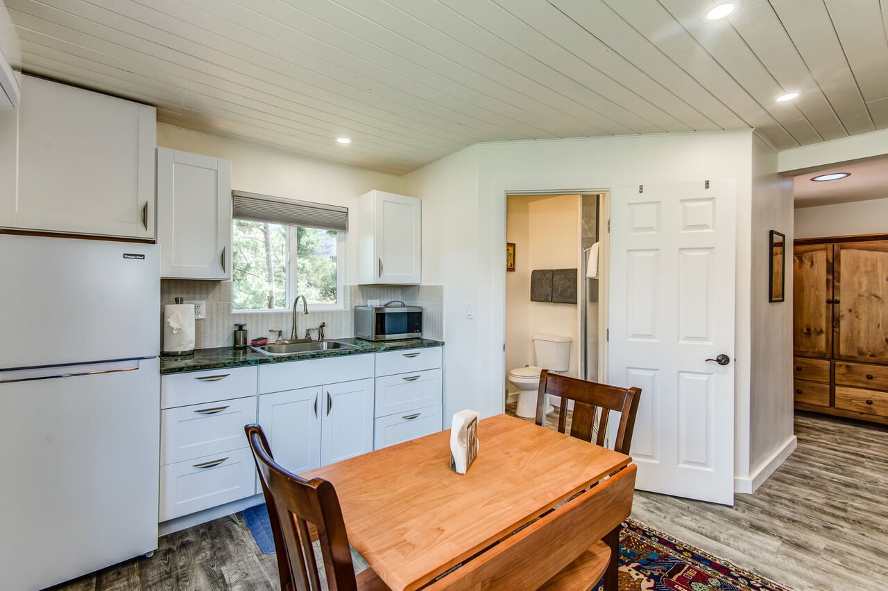 Studio Kitchenette with a Refrigerator, Microwave and Coffee Machine
