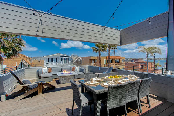 Expansive Top Floor Deck w/ Outdoor Dining, Fire Pit, & Beach and Bay Views - Third Floor