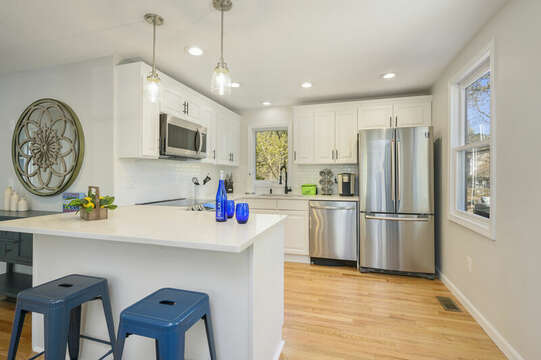 Kitchen with eat at counter, stainless appliances -875 Great Pond-Eastham- Cape Cod- New England Vacation Rentals
