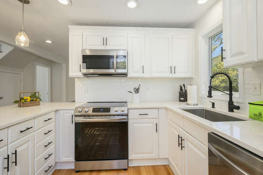 Kitchen with granite counters and stainless appliances-875 Great Pond-Eastham- Cape Cod- New England Vacation Rentals