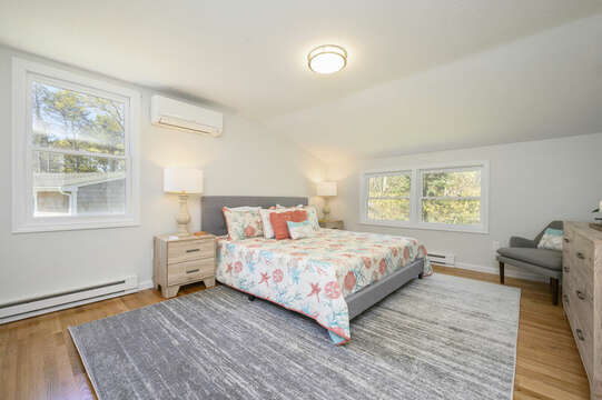Bedroom #1 Master with King bed, dresser and occasional chair-875 Great Pond-Eastham- Cape Cod- New England Vacation Rentals