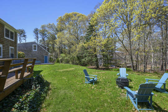 Large back yard with fire pit-875 Great Pond-Eastham- Cape Cod- New England Vacation Rentals