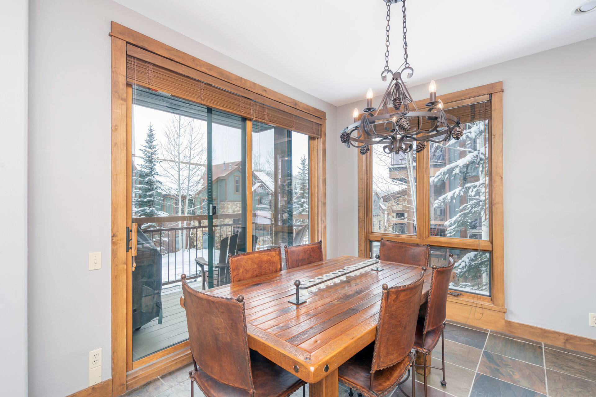 Dining room with wood furniture and snowy views