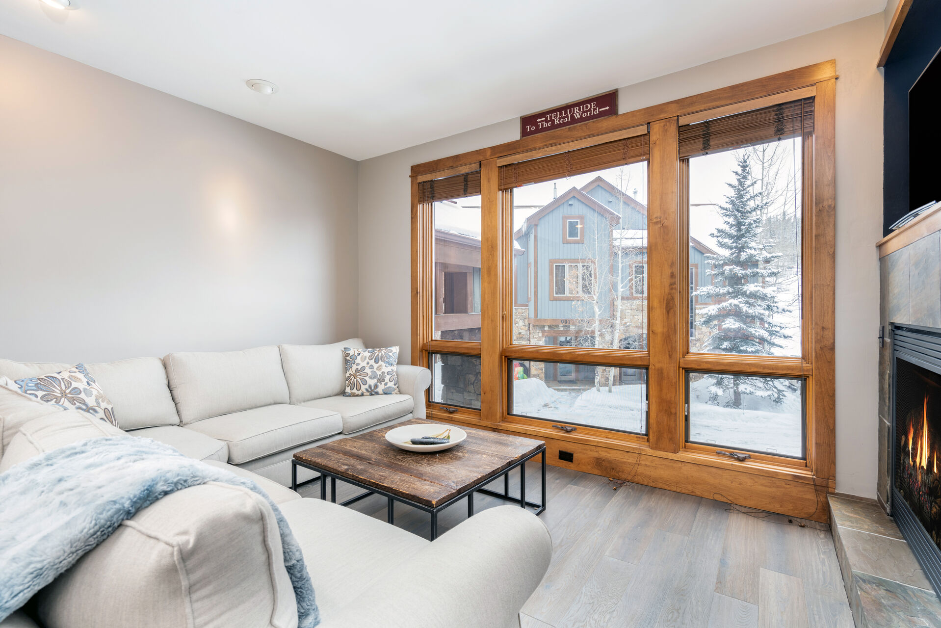 Living room with wood-framed window and snowy background