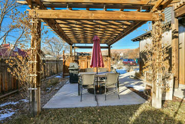 BBQ Grill and Outdoor Dining Set with Umbrella.